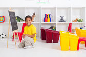 Preschool boy in classroom — Stock Photo