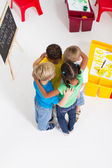 Group of preschool kids hugging — Stock Photo