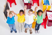 Young preschool children in classroom — Stok fotoğraf