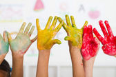 Kids hands covered with paint — Stock Photo