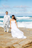 Bride and groom on beach — Photo
