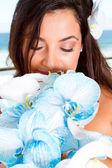 Bride smelling bouquet — Stock Photo
