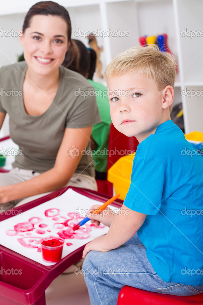 Preschool boy and teacher in classroom — Stock Photo #10683106