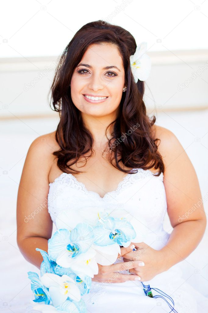 Beautiful young bride with bouquet  Stock Photo #10685994