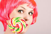 Beautiful girl with a big lollipop — Stock Photo