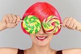 Girl with a charming smile played with candy — Stock Photo
