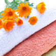 Towels And Calendula Flowers — Stock Photo