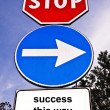Traffic sign saying Success This Way - Stock Photo