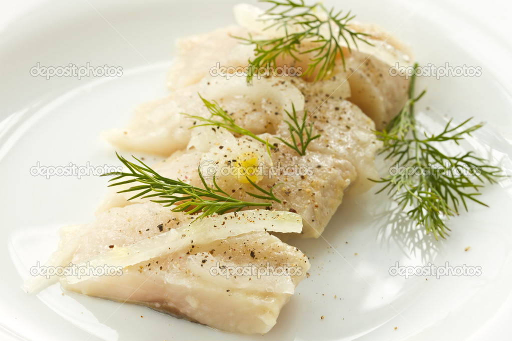 Slices of marinated herring with onions on a plate  Stock Photo #10177018