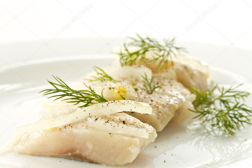 Slices of marinated herring with onions on a plate — Stock Photo #10177033