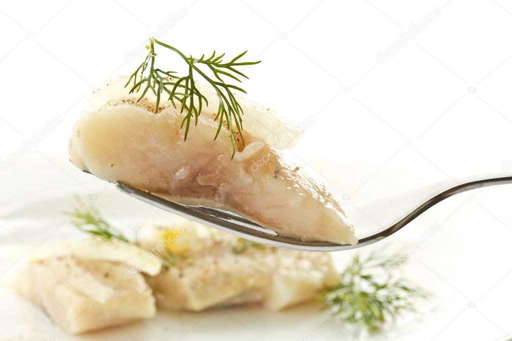 Slices of marinated herring with onions on a plate — Stock Photo #10177072