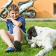 The boy with his dog - Lizenzfreies Foto