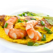 Omelet with cooked shrimp and greens — Stock Photo
