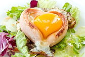 Scrambled eggs with sausage in a heart — Stock Photo
