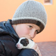Teenager with a puppy — Stock Photo