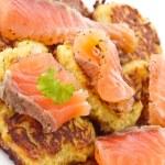 Fried potato pancakes with salted salmon — Stock Photo #8997354