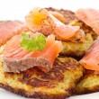 Fried potato pancakes with salted salmon — Stock Photo
