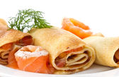 Pancakes with salted red fish — Stock Photo