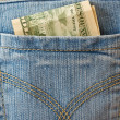 Stock Photo: Dollars in back pocket of jeans