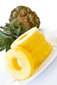Peeled slices of pineapple — Stock Photo