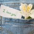 Flower and a declaration of love — Stock Photo