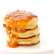 Stock Photo: Pancakes with apricot syrup