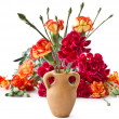Stock Photo: Bright carnation flowers in clay pot