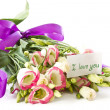Stock Photo: Declaration of love and a bouquet of flowers lisianthus