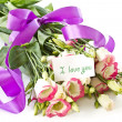 Stock Photo: Declaration of love and bouquet of flowers lisianthus
