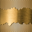 Photo: Golden metal grate background