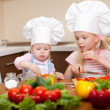 Two little girls preparing healthy food on kitchen — Stock Photo #8233937