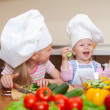 Two little girls preparing healthy food on kitchen — Stock Photo #8325515