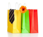 Shopping bags with purchases for family on white background with — Stock Photo