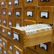 Old wooden card catalogue with one opened drawer — Stock Photo #8383217