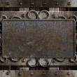 Vintage metal plate  on old oak door - Stock Photo