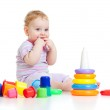 Cute little boy playing colorful toys isolated on white — Stock Photo #8833651