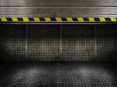 Grungy metal industrial plates room with rolled up door — Foto Stock