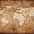 Stock Photo: Grunge world map background with rose compass