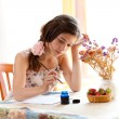 Girl writing at table by pen and ink indoor in summer day with s — Stock Photo #9454077