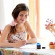Girl writing at table by pen and ink indoor in summer day with s — Stock Photo #9454080