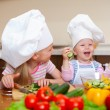 Two little girls preparing healthy food on kitchen — Stock Photo #9779534
