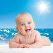 Royalty-Free Stock Photo: Adorable baby lying on sea beach