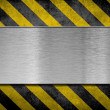 Metal plate background with hazard stripes — Stock Photo