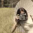 Beautiful photographer. Photo in old image style. — Stock Photo