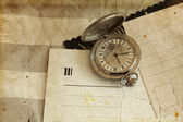 Antique pocket watches and old postcards — Stock Photo