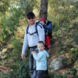 Stock Photo: Father hiking with two children