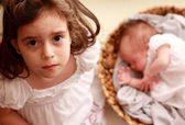 Girl with newborn sister — Stock Photo