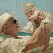 Happy grandpa is holding a little granddaughter. — Stock Photo #8612142