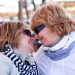 Stock Photo: Mother and daughter on a winter beach