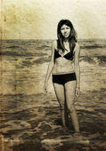 Beautiful girl on the beach. Photo in old color image style. — Zdjęcie stockowe